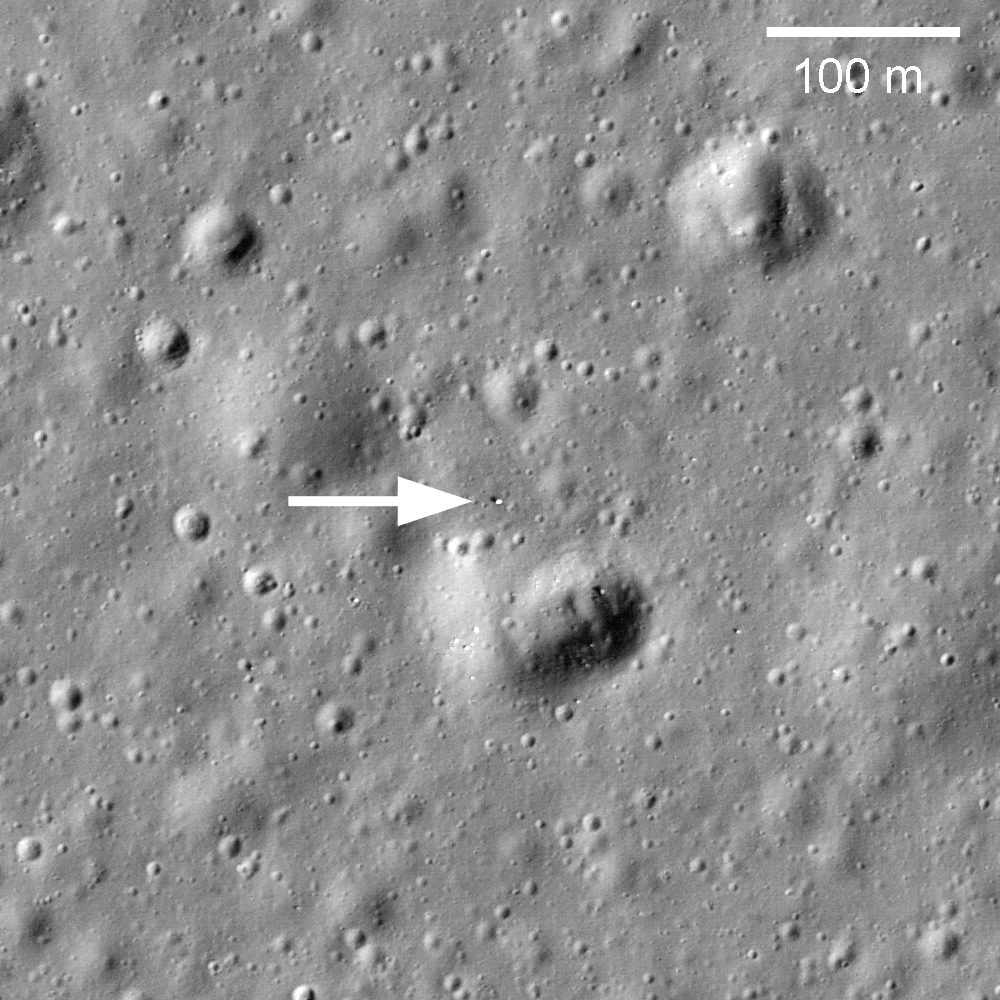 Black and white image showing speck of a rover on the surface from high above the Moon.