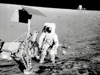 Footpads and Footprints: Humans and Machine Meet on the Moon