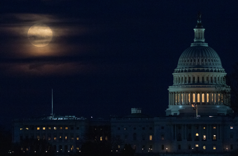 The Moon as it rises behind the U.S. Capitol, Monday, March 9, 2020, in Washington, DC.  Photo Credit: NASA/Joel Kowsky