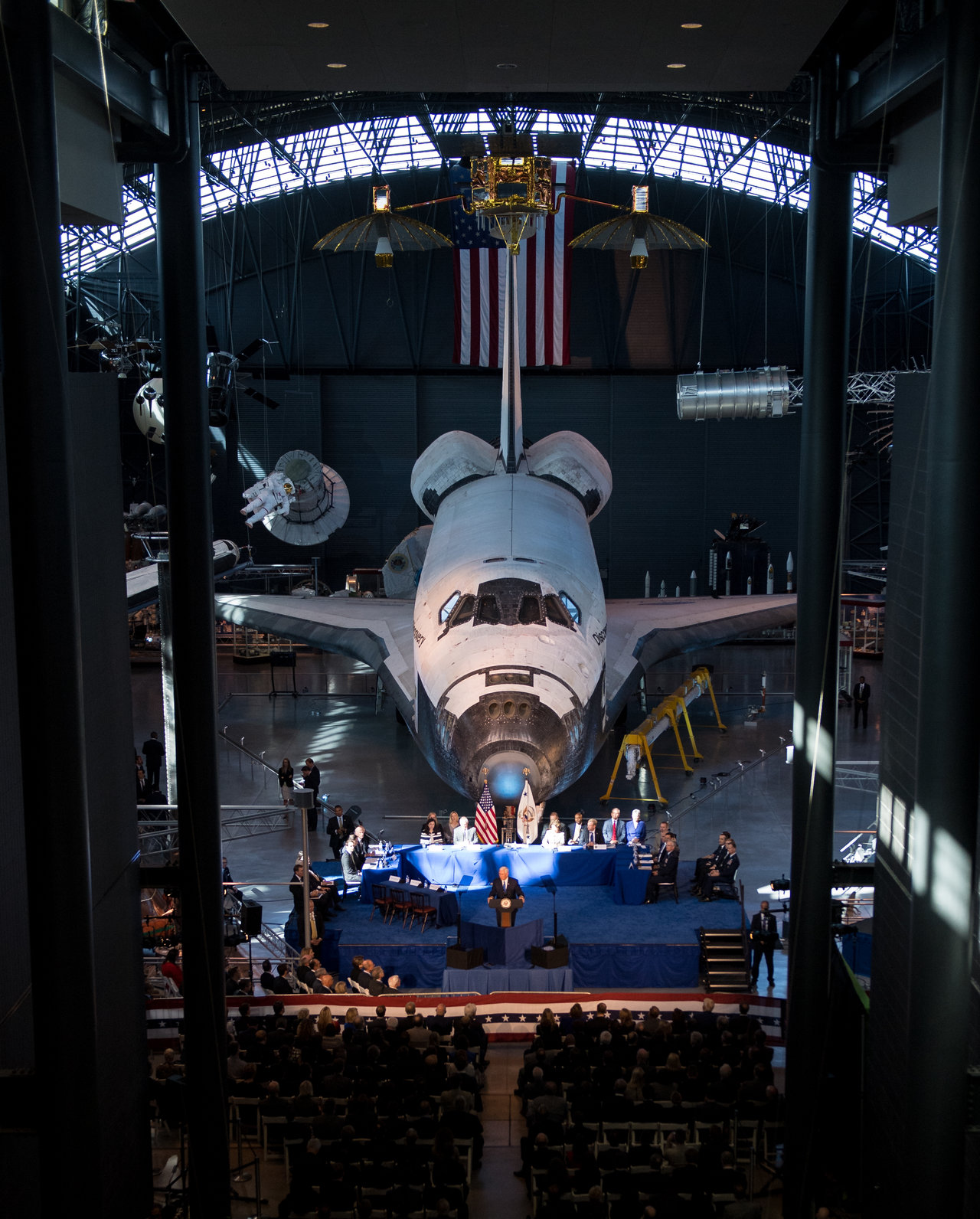 Color image of Vice President giving a speech in front of the Space Shuttle at the Smithsonian.