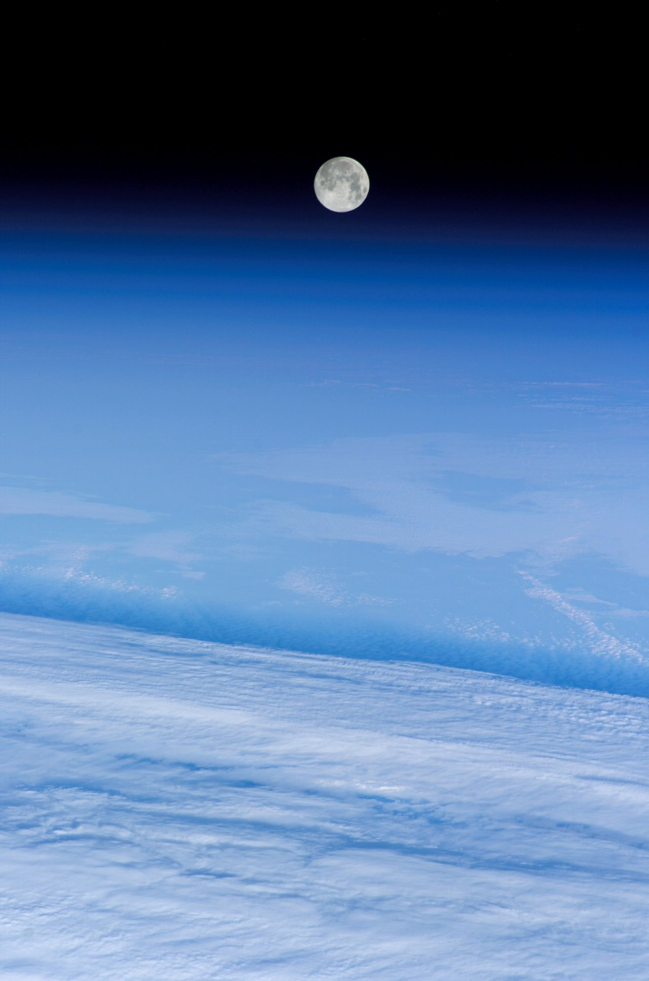 """Snow Moon"" over Earth taken by the International Space Station, 02/12/06. Credit: NASA"