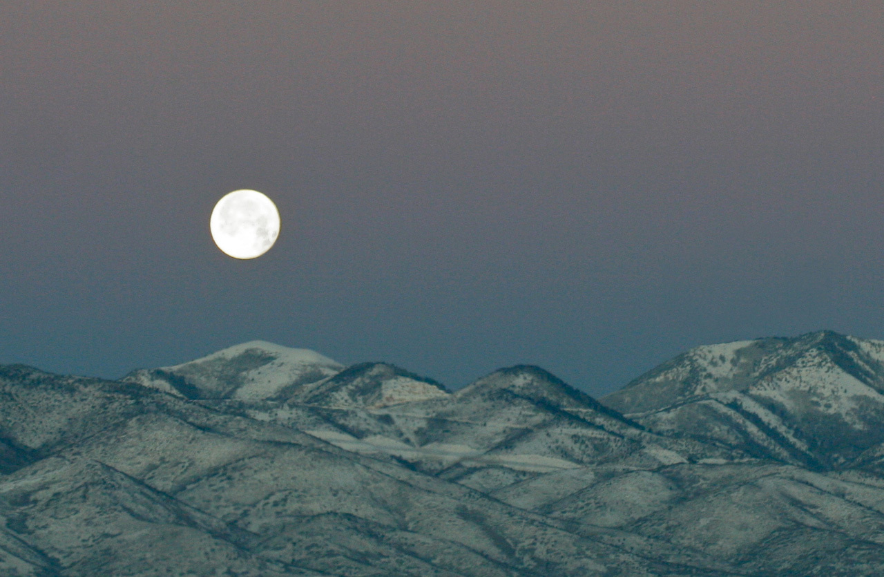Moon over mountains.