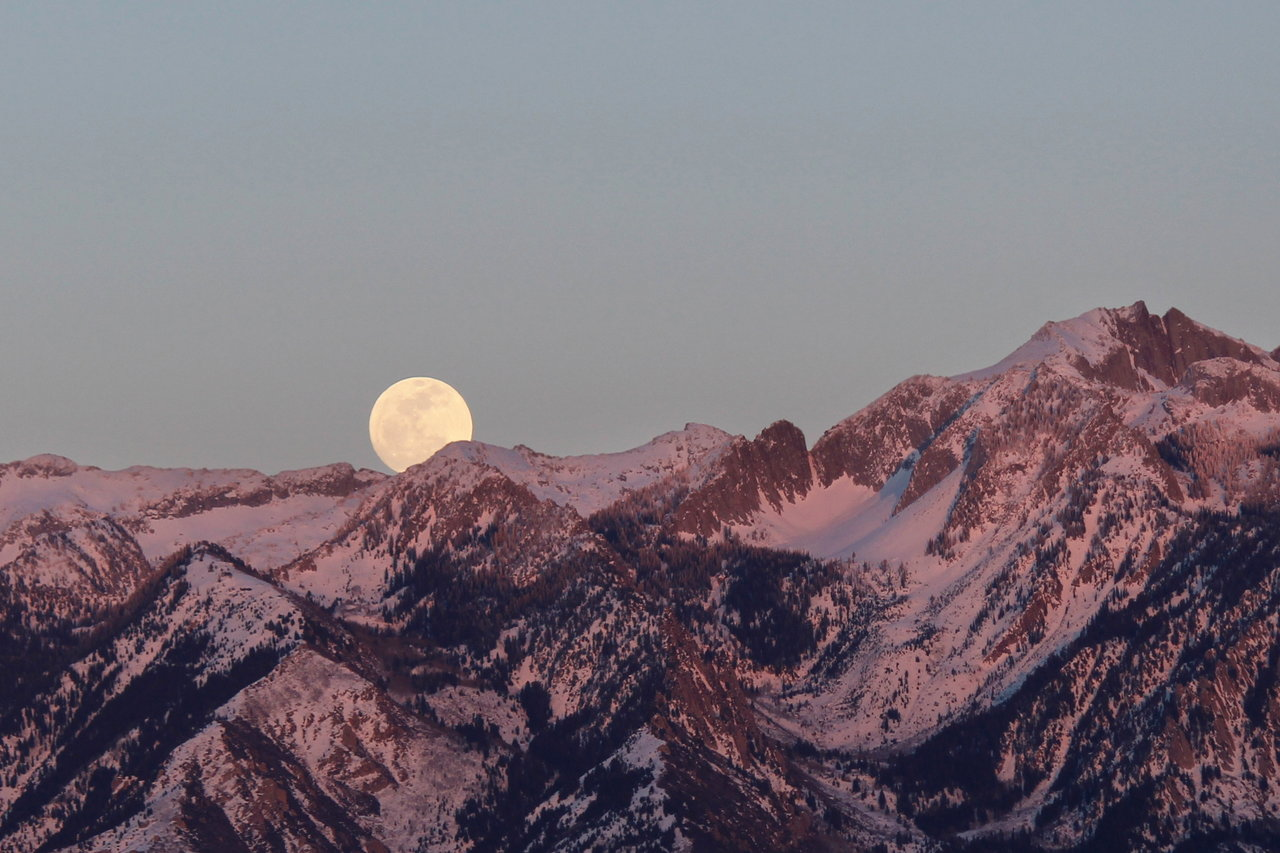 Full Moon over mountains.
