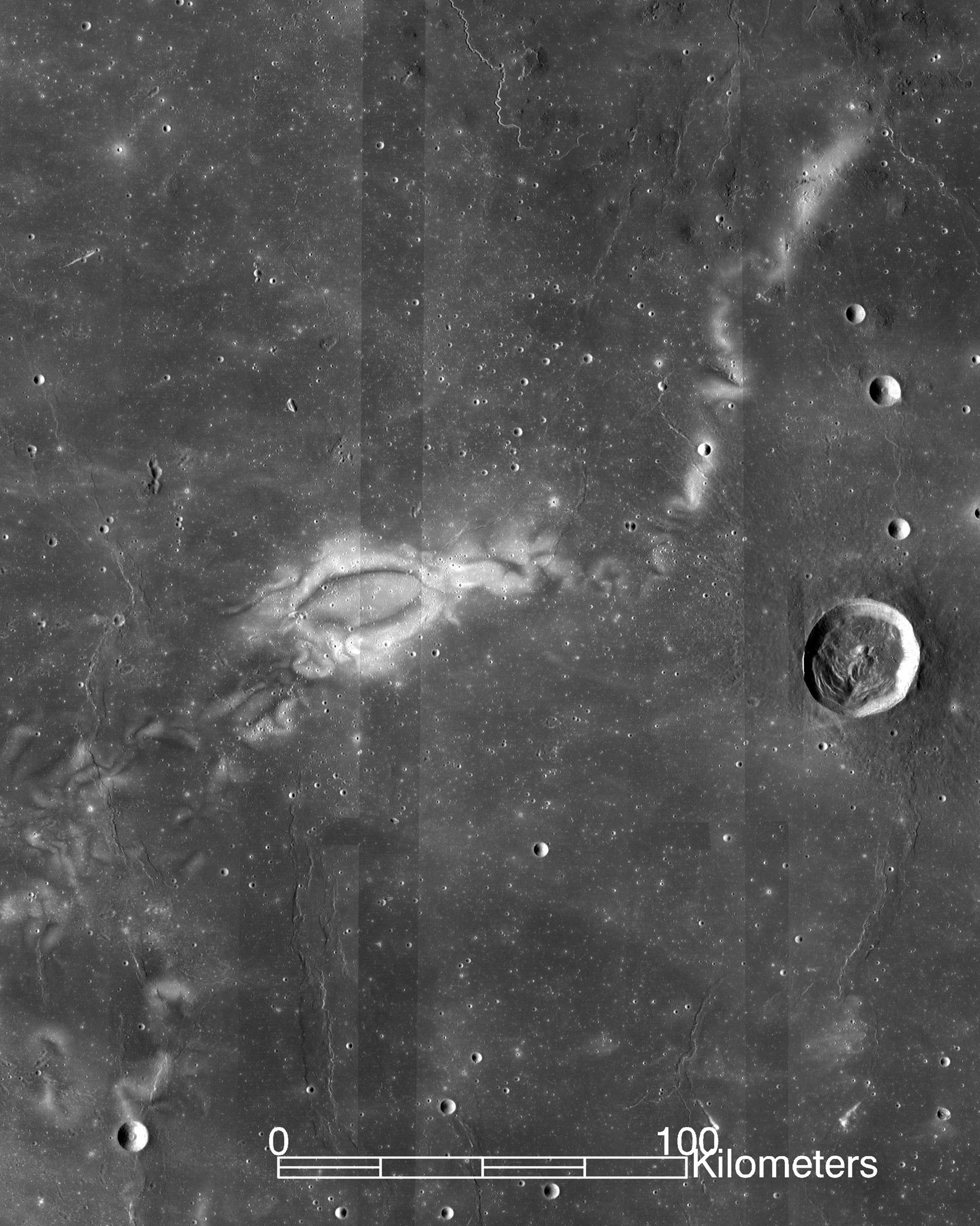 Black and white image of whitish swirls on the surface of the moon.