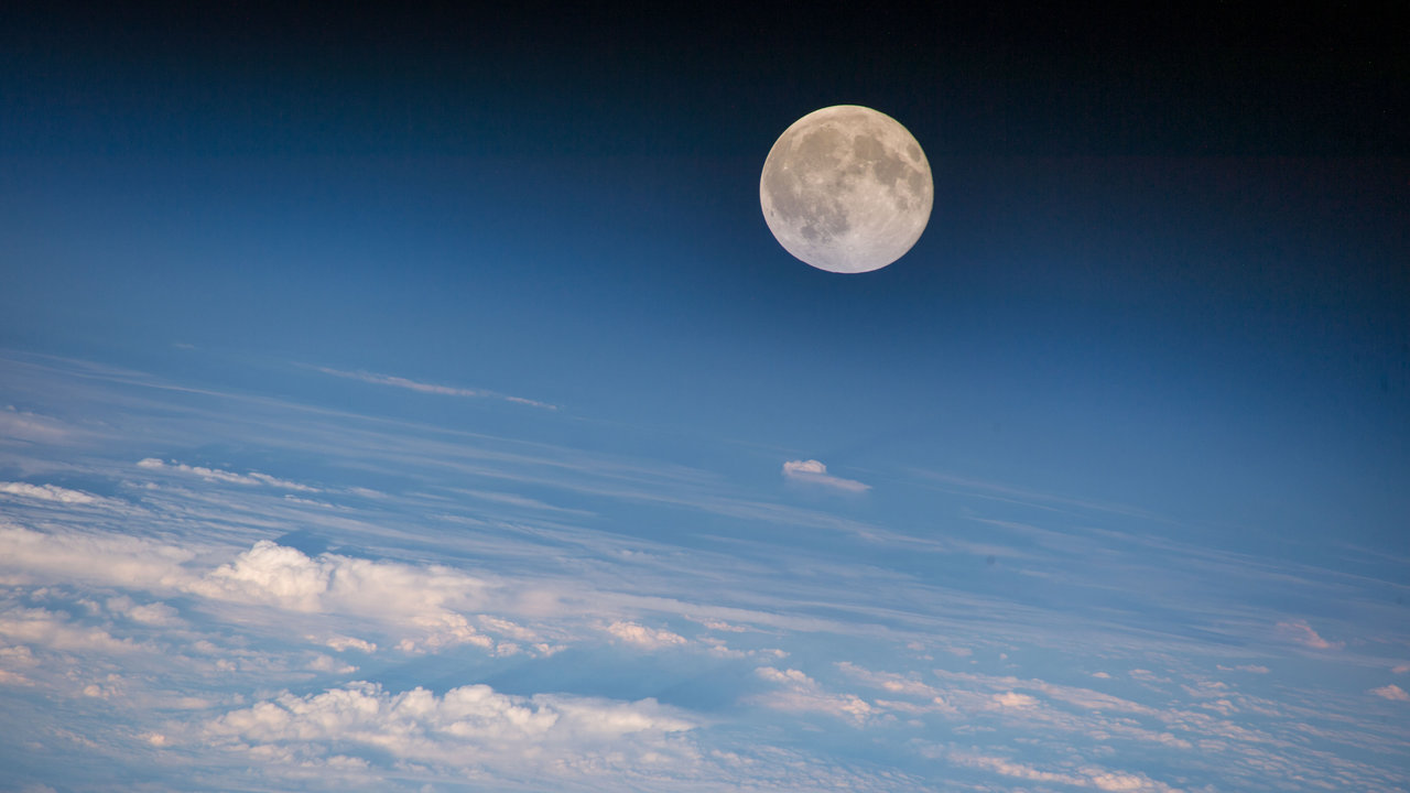 Color image of the moon above Earth's clouds.