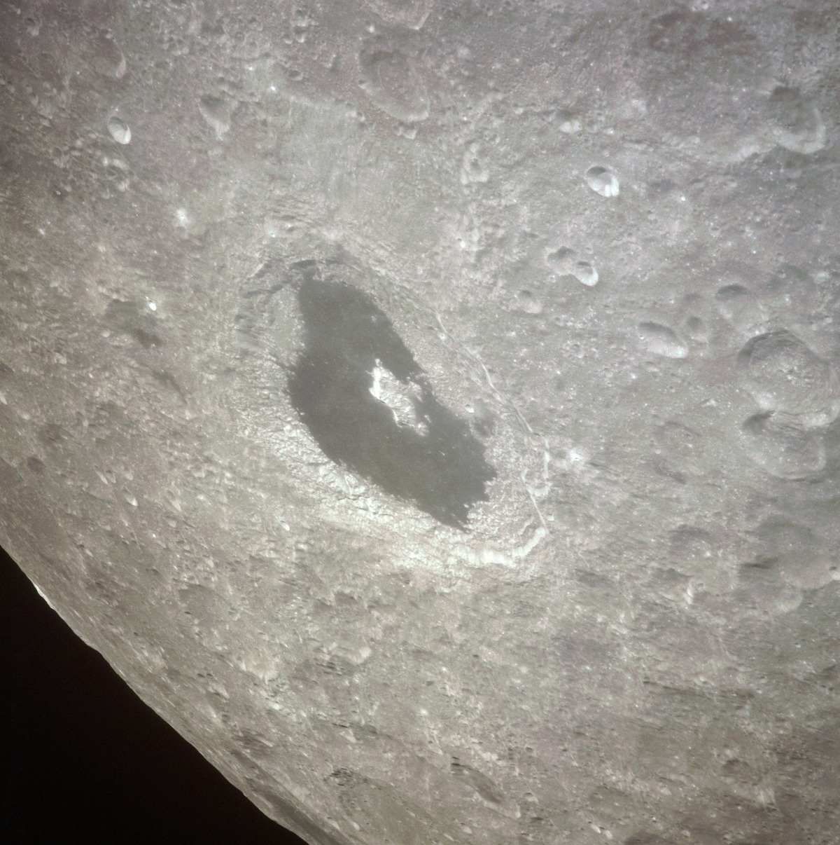 large lunar crater filled with dark, solidified lava