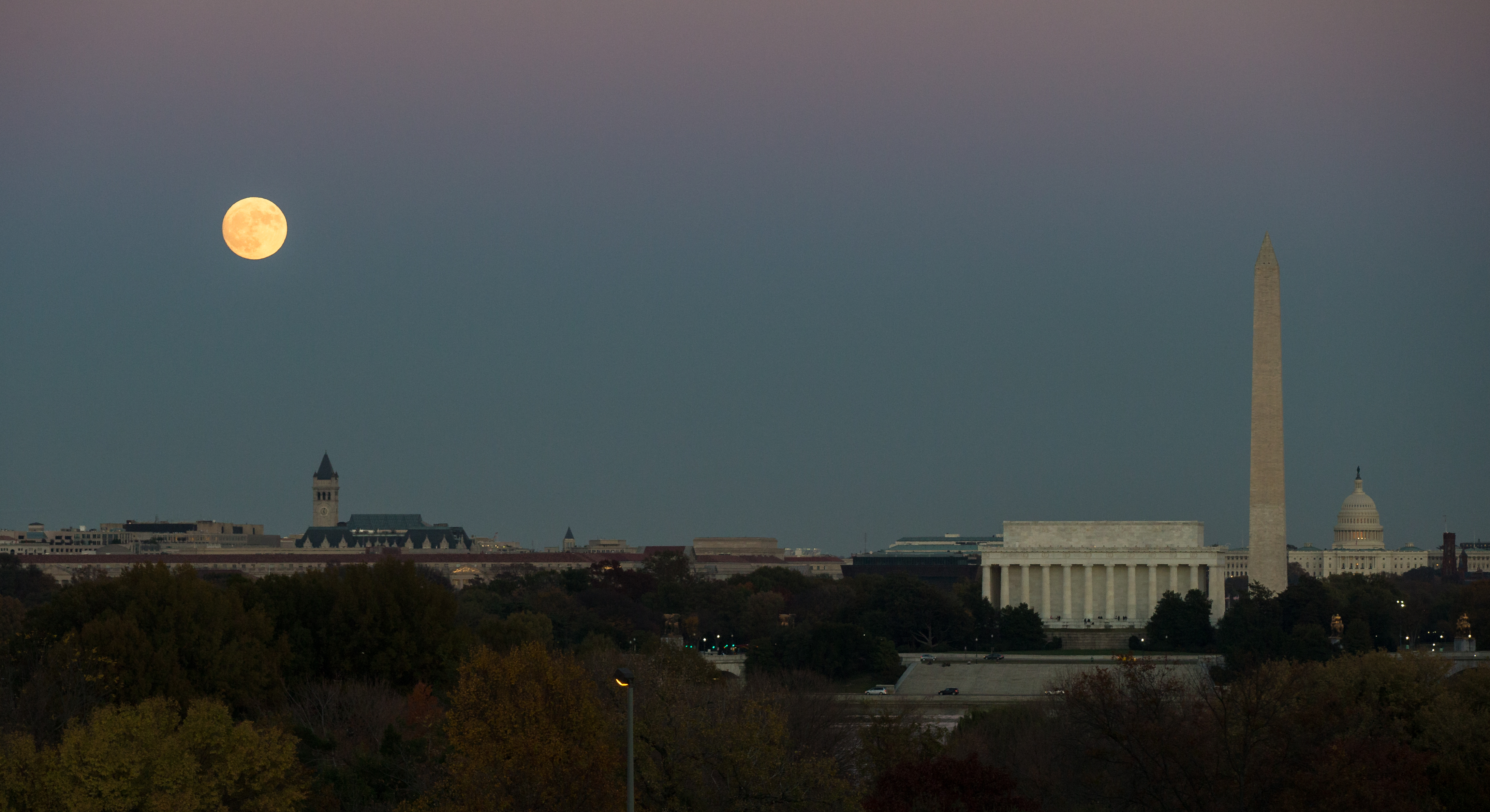 The moon is seen as it rises over Washington, D.C.