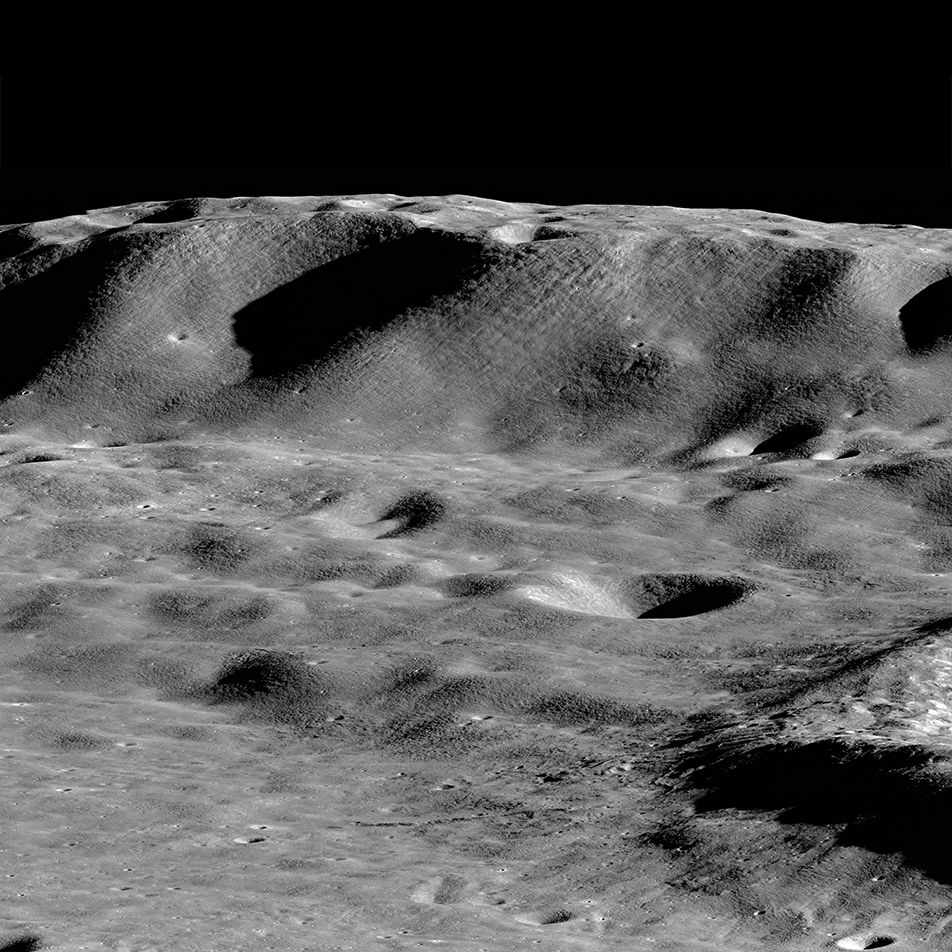 mountain and craters on lunar surface