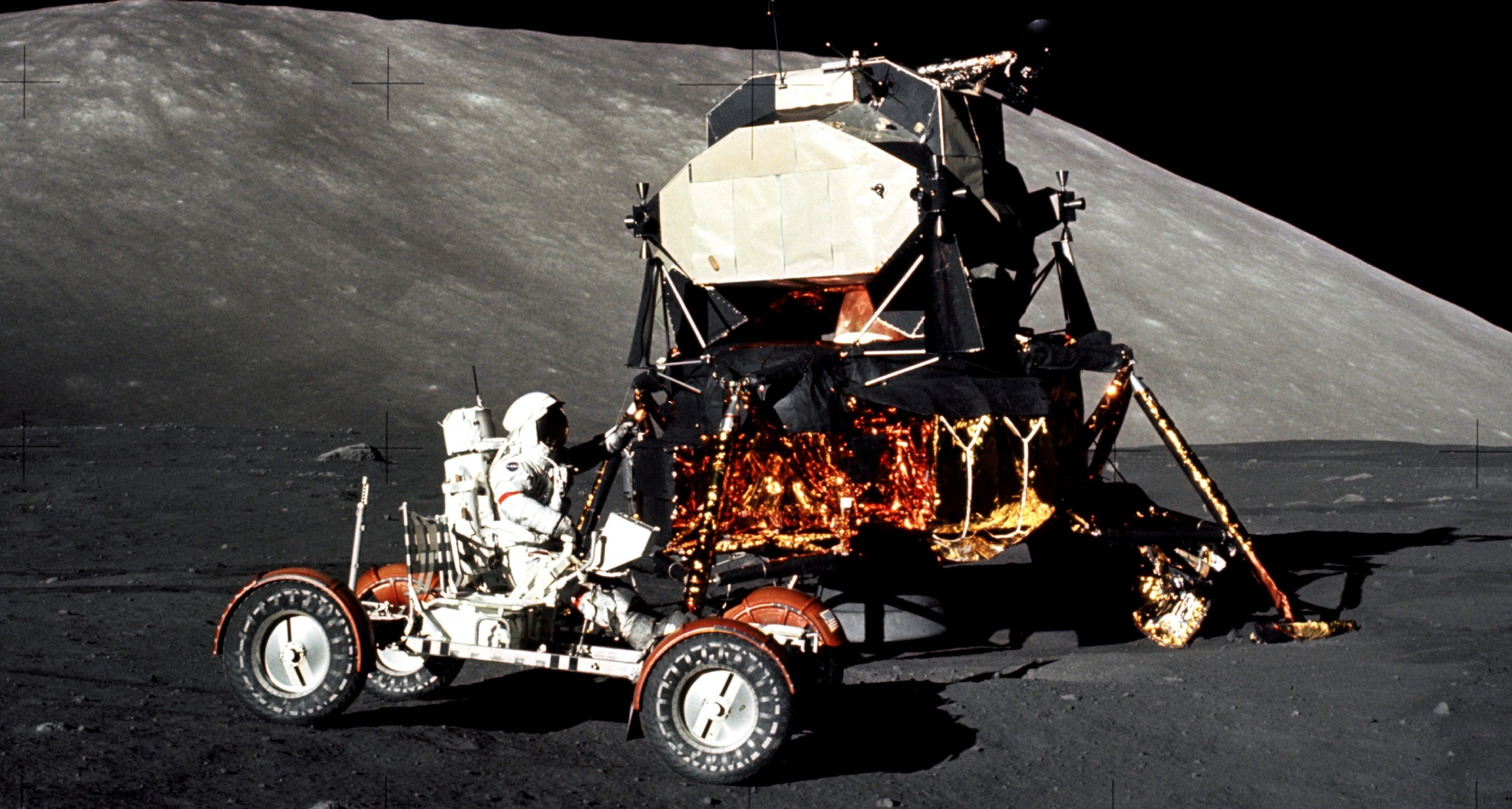 Man in moon buggy on the Moon.