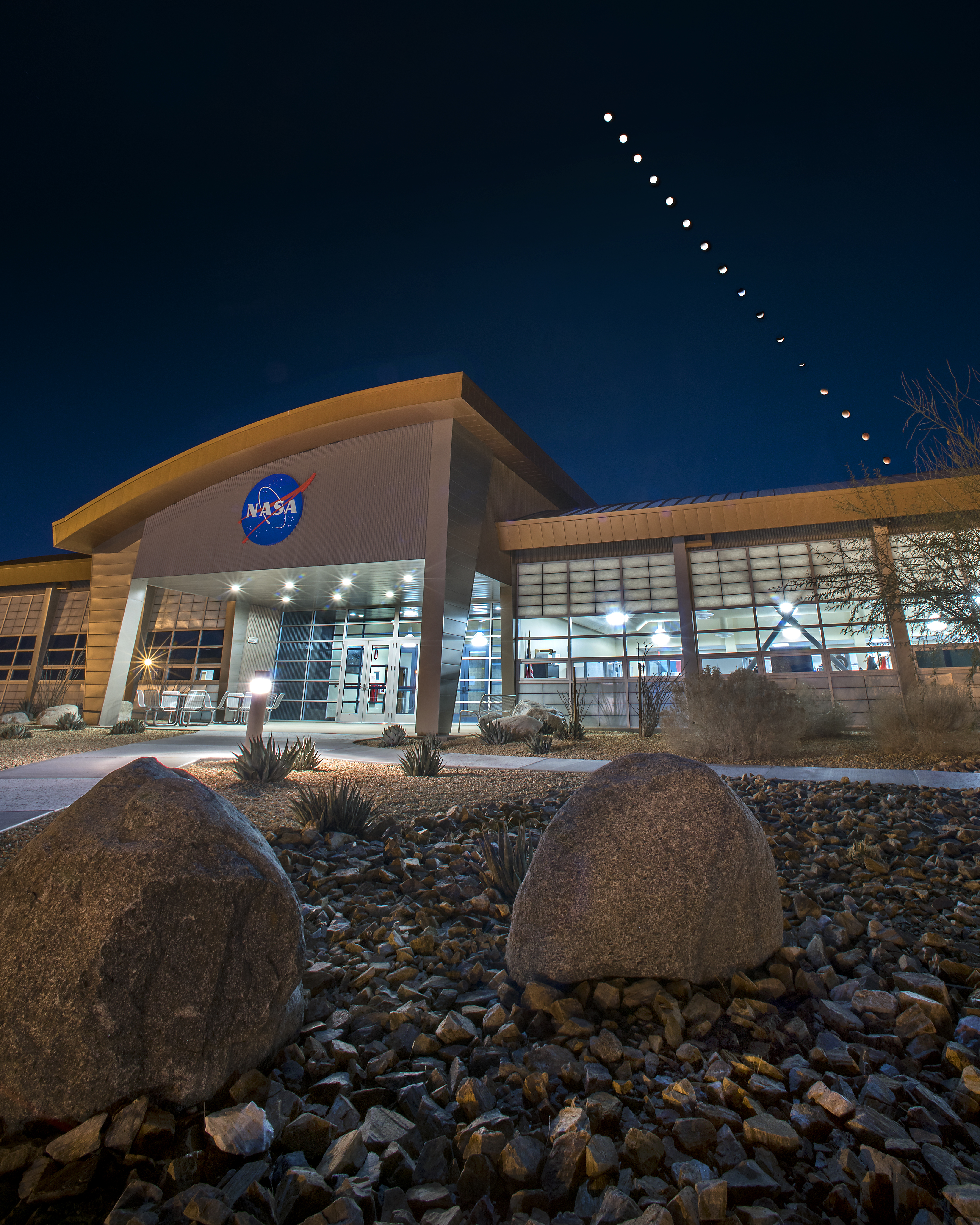 Sequence showing the Moon descending into eclipse above a NASA building.