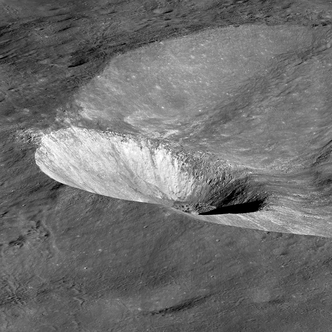crater on a slope of a larger crater