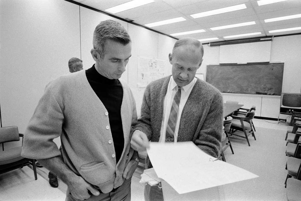 2 men looking at a sheet of paper
