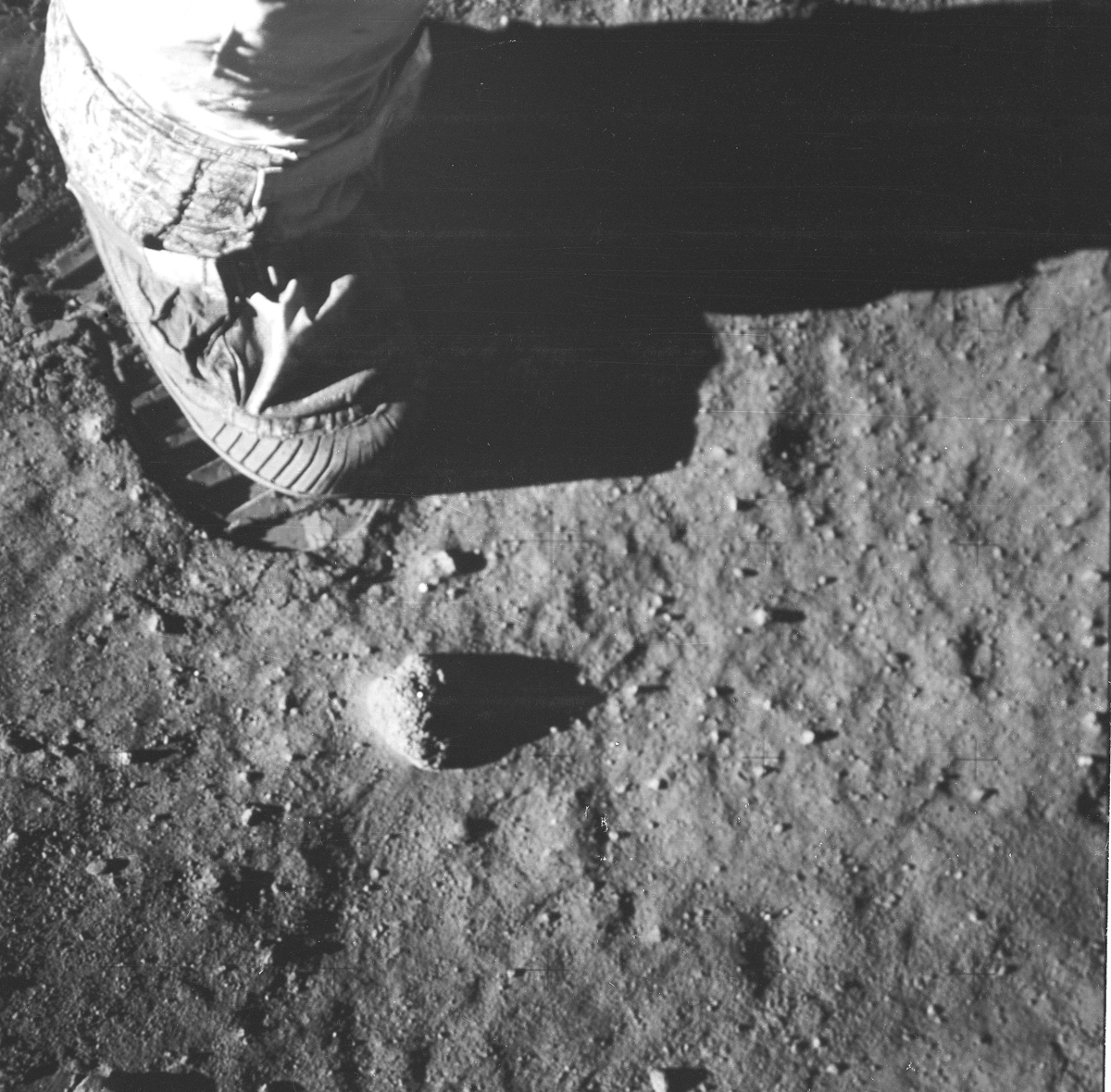 Astronaut's foot and footprint on lunar soil
