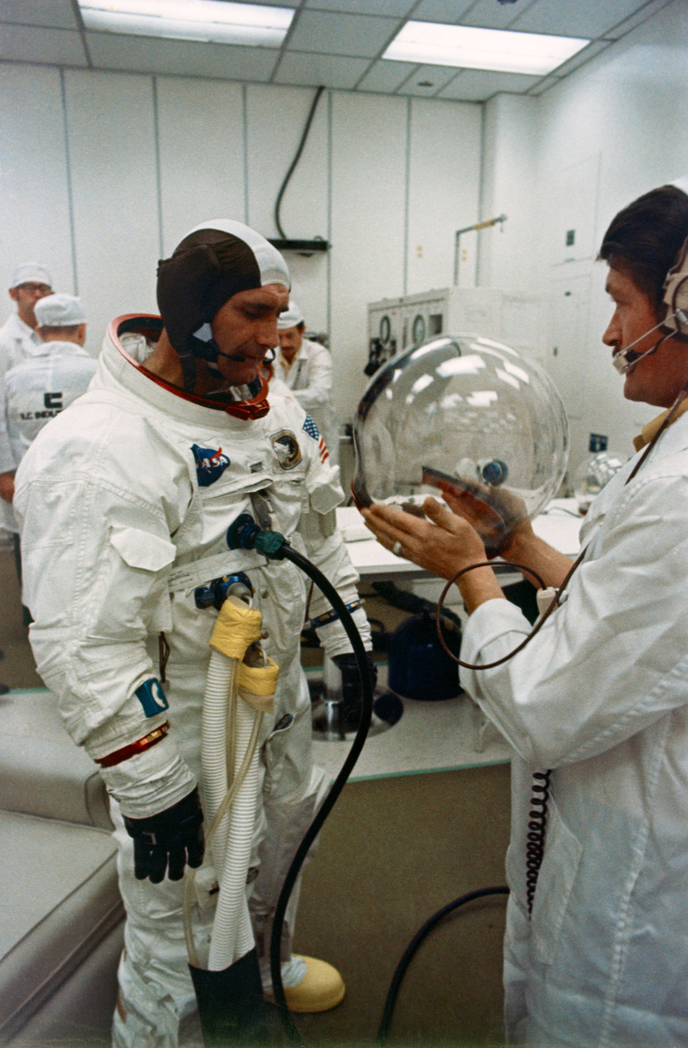 Astronaut putting on his helmet