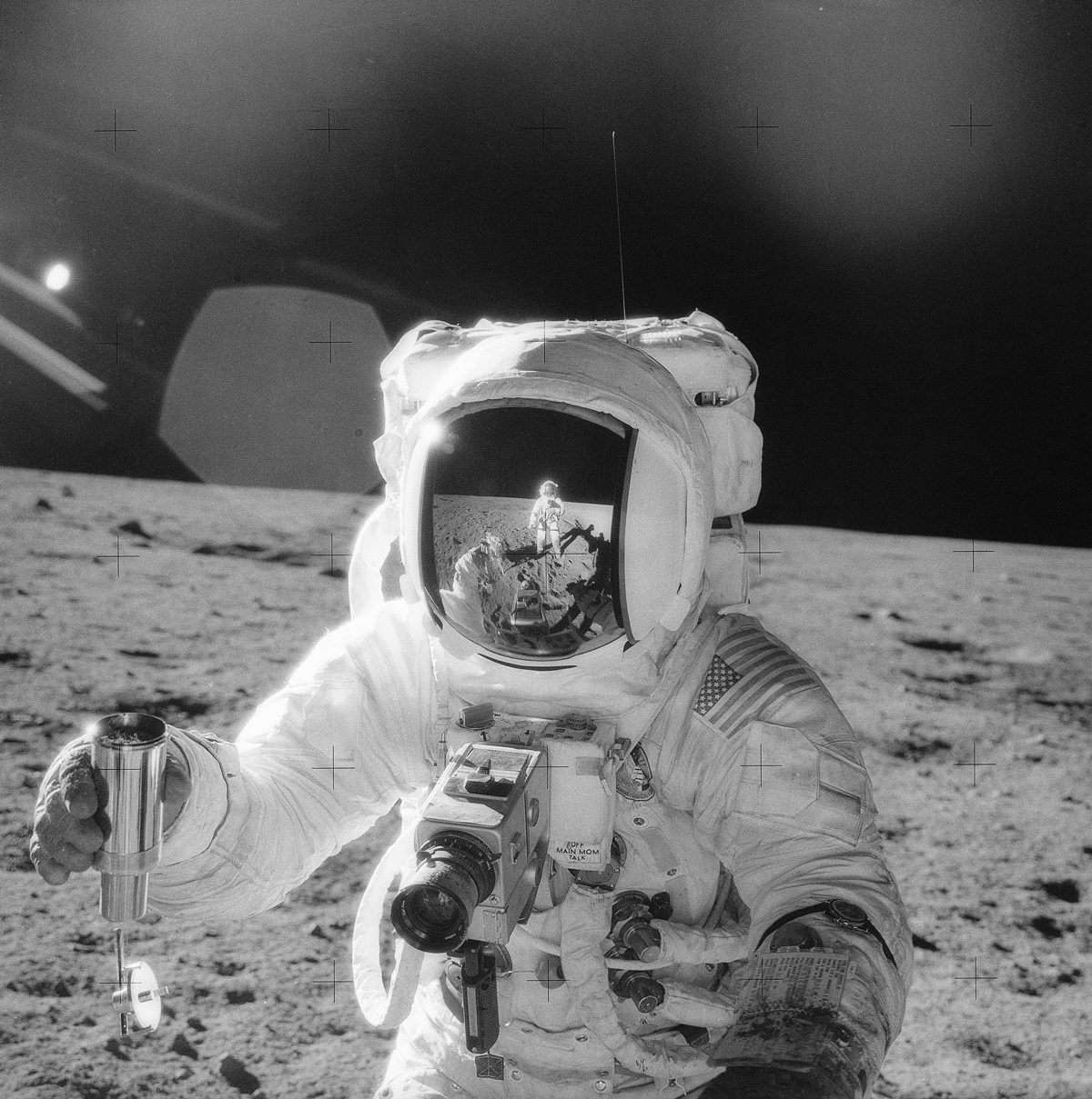 Astronaut collecting rock samples on the moon