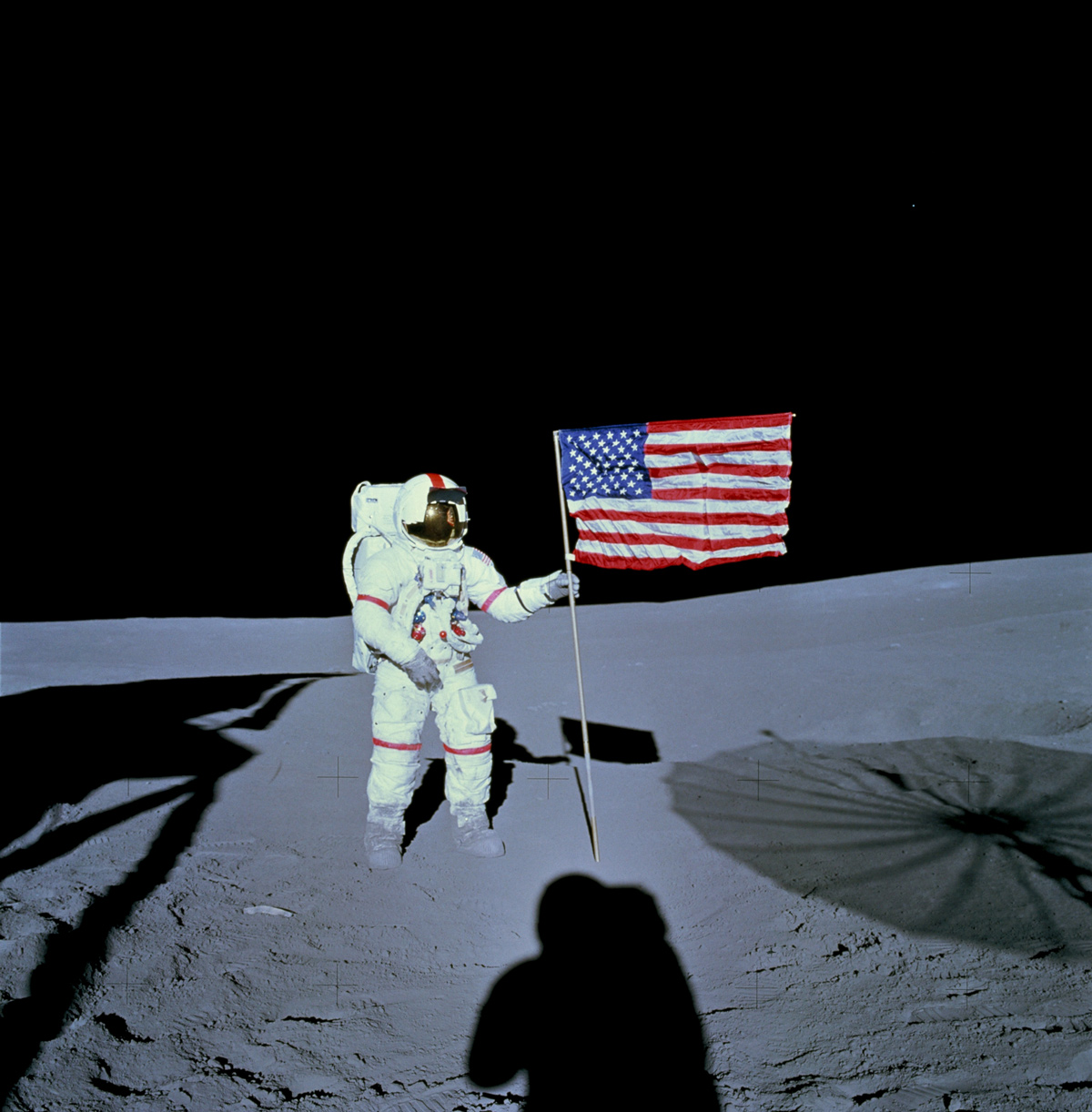 Astronaut holding American flag on the moon