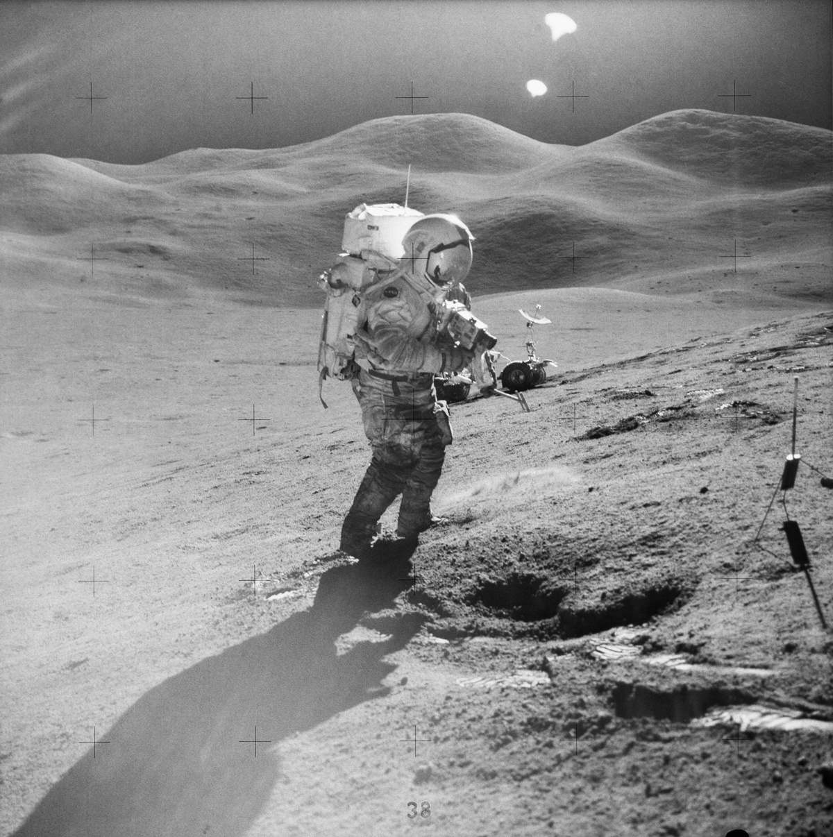 Astronaut photographing the lunar surface