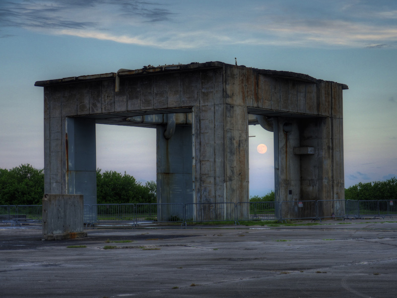 moon rising over concrete structure