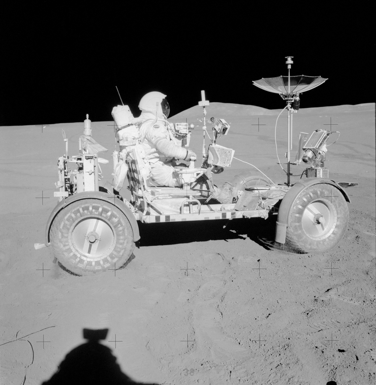 Astronaut driving rover on the moon