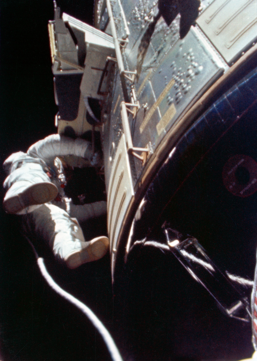 Astronaut floating in space outside spacecraft