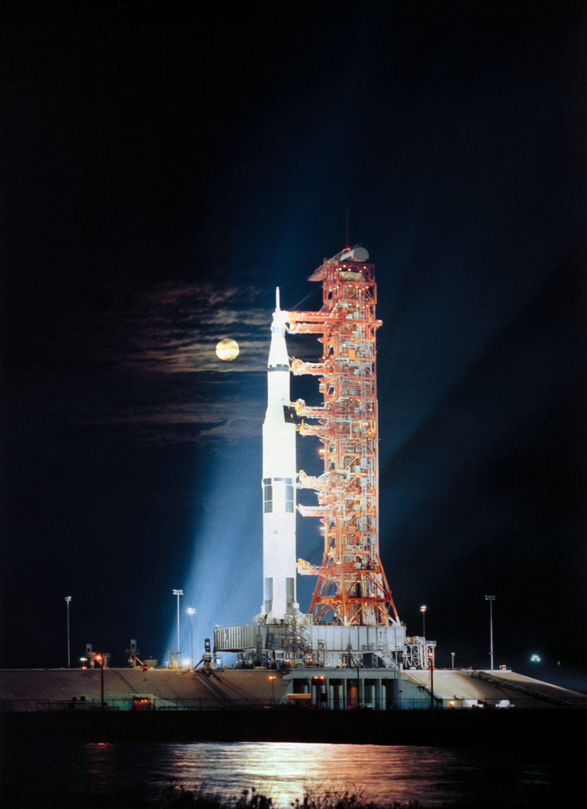 Spacecraft on launchpad with full moon in background