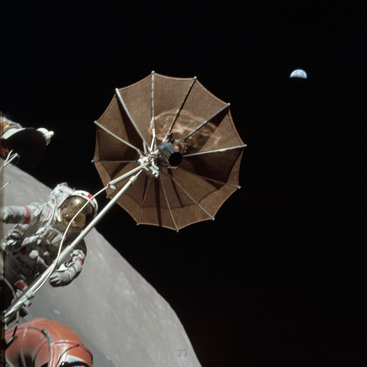 Astronaut on moon holding antenna with Earth in the background
