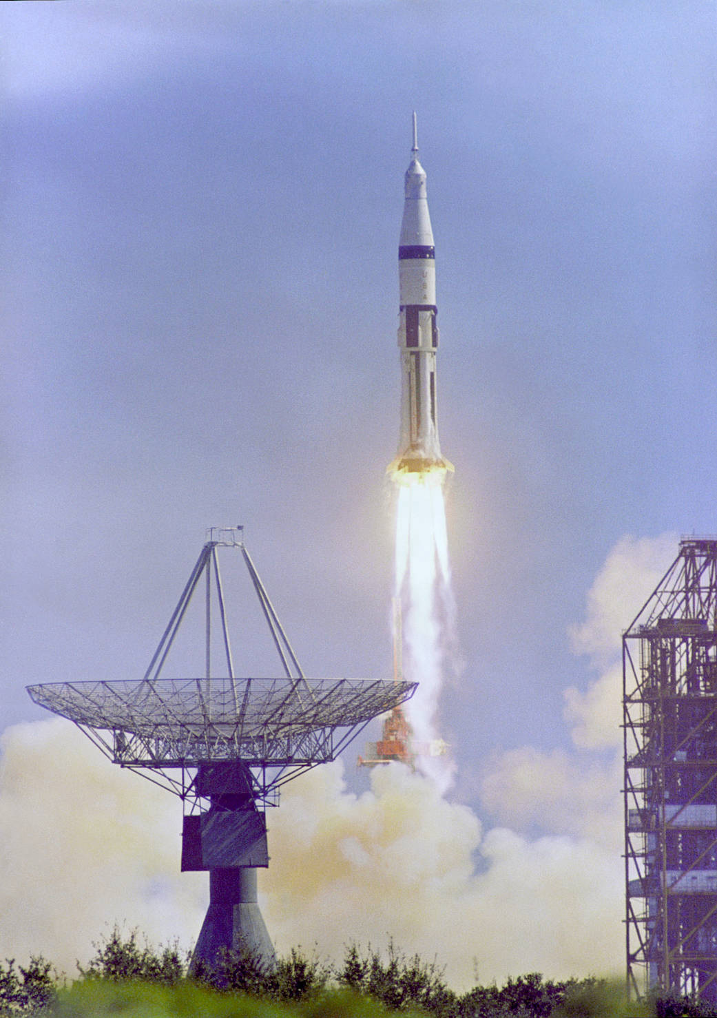 Apollo 7 spacecraft launching with large antenna in foreground