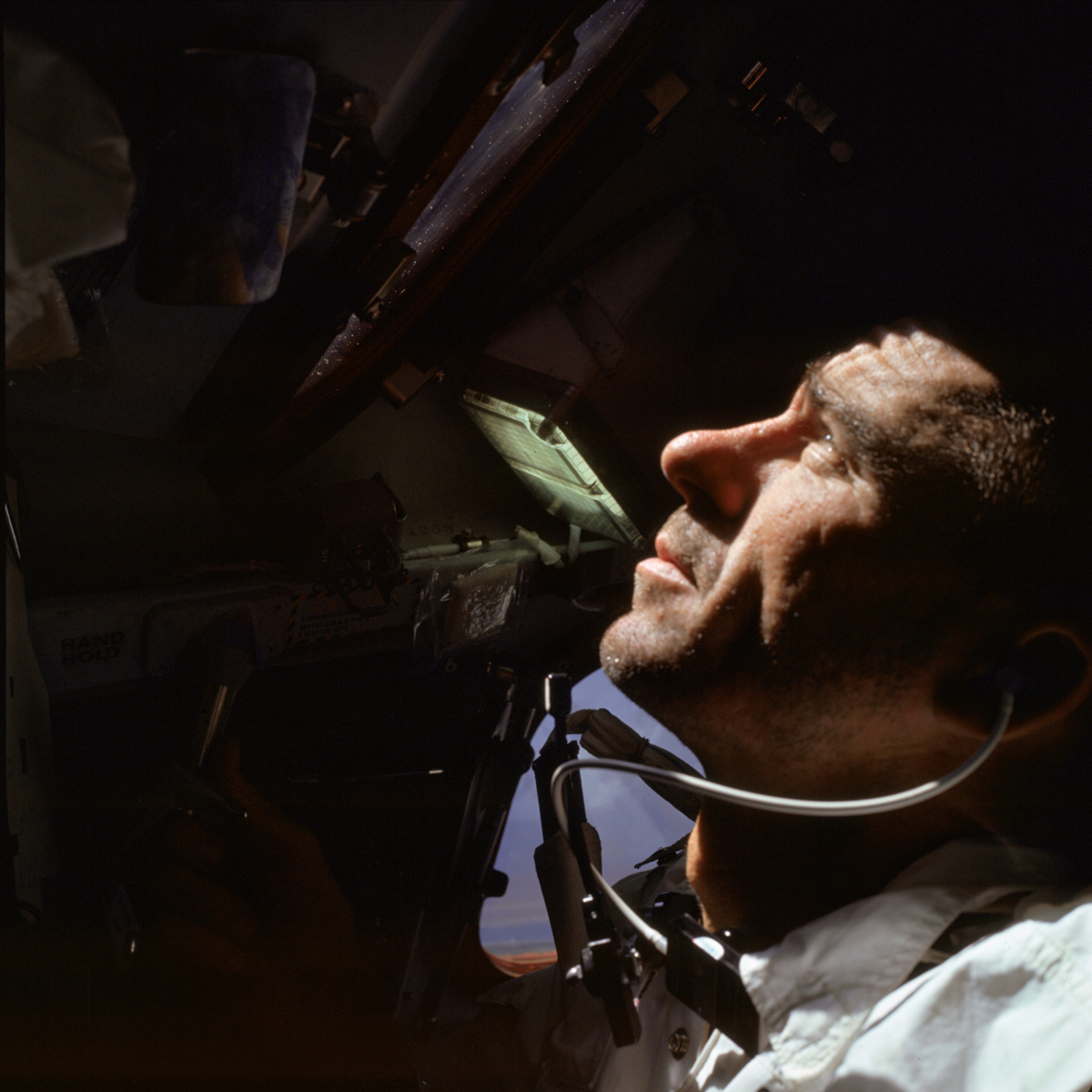 Man inside spacecraft, looking up