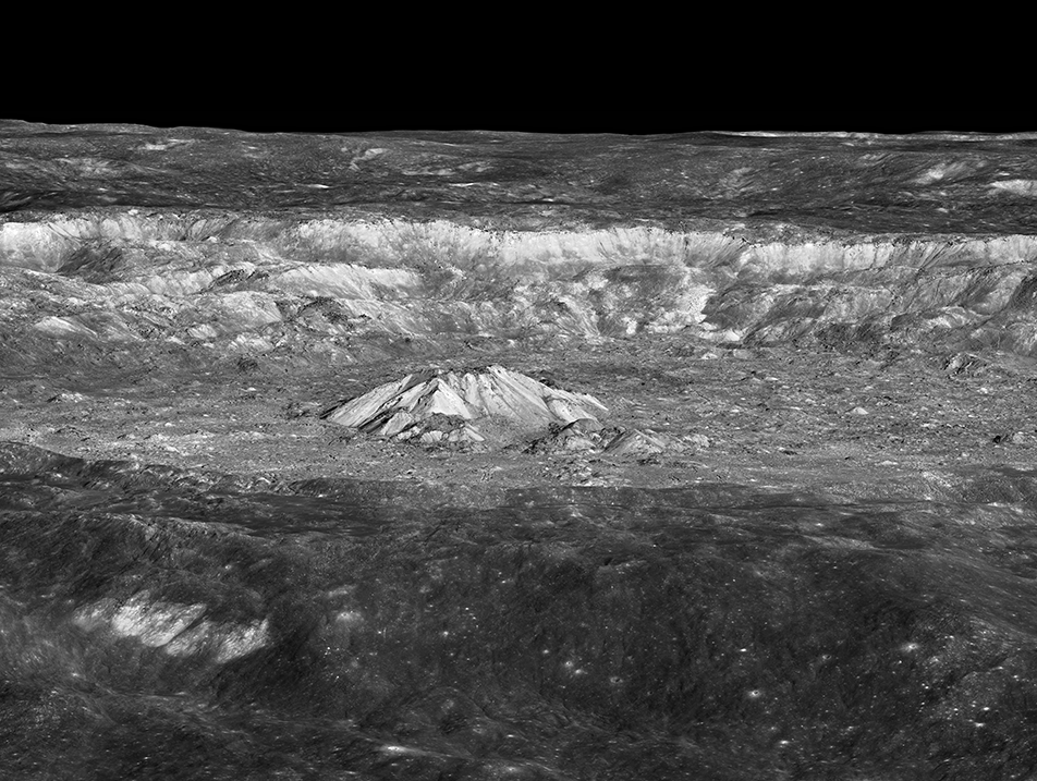 Black and white image of mountains in a crater on the Moon.