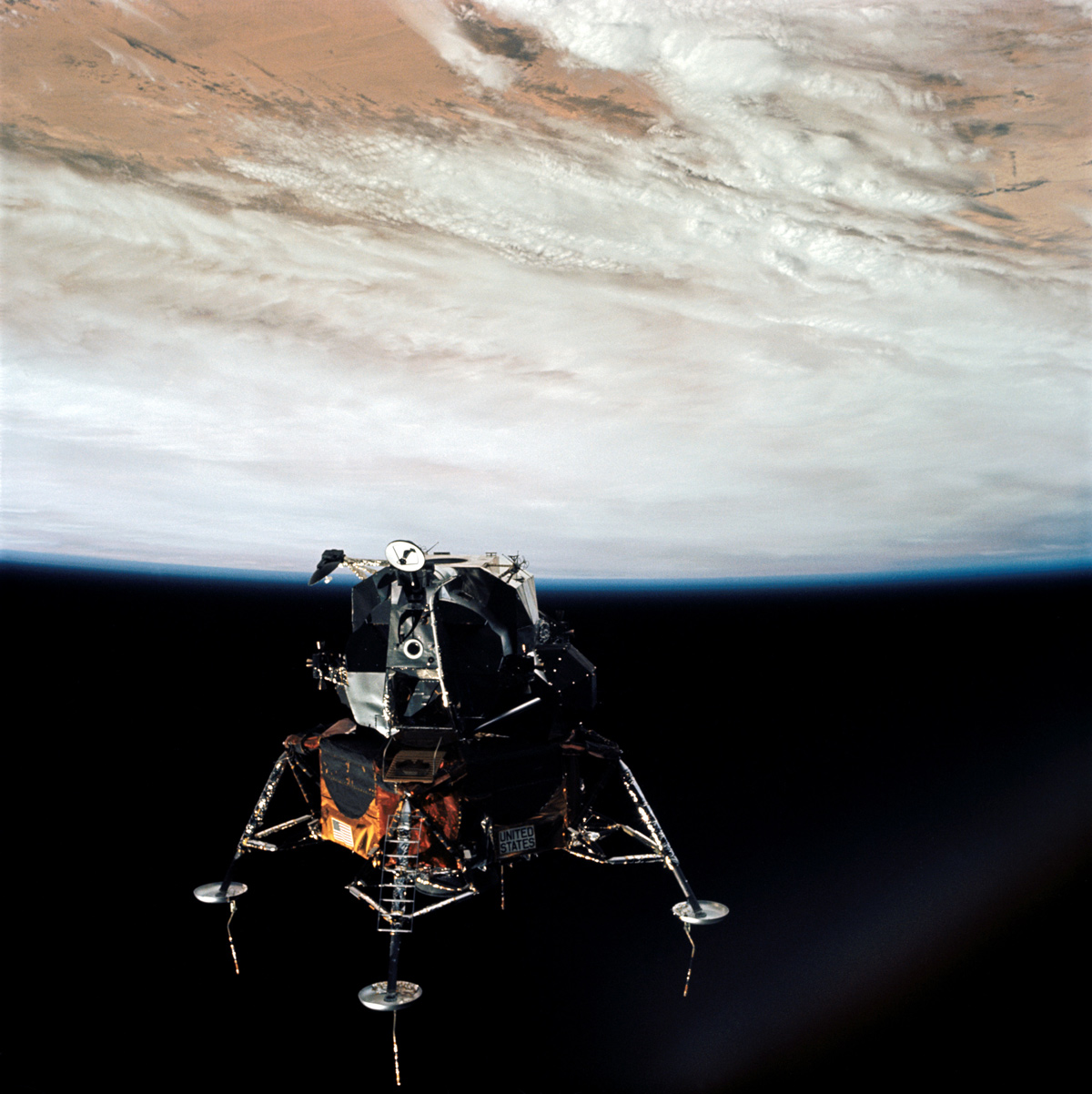 Apollo 9 Lunar Module in space with Earth in the background