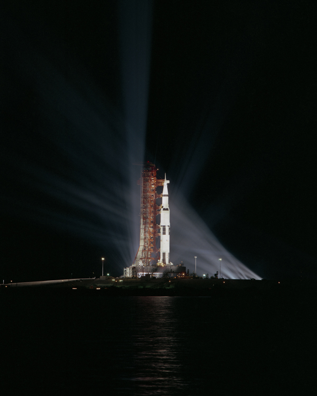 Searchlights illuminate the Apollo 8 spacecraft at night