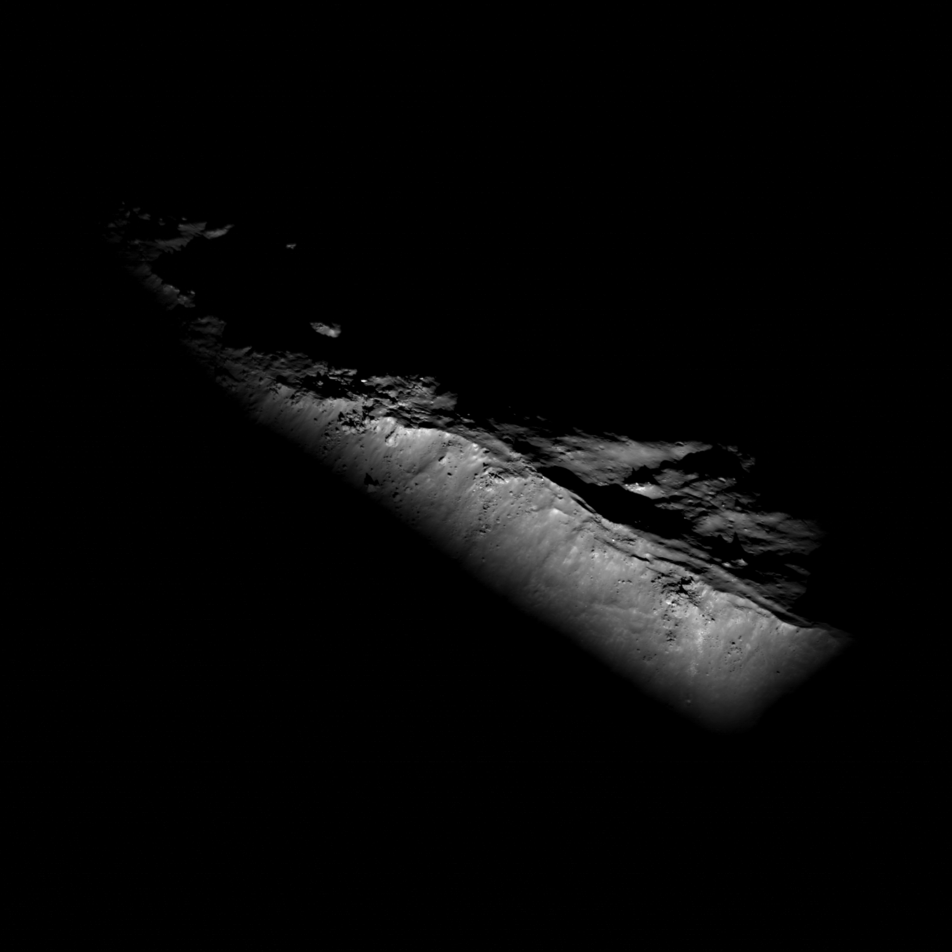 Black and white image of ridge emerging from shadows on the Moon.