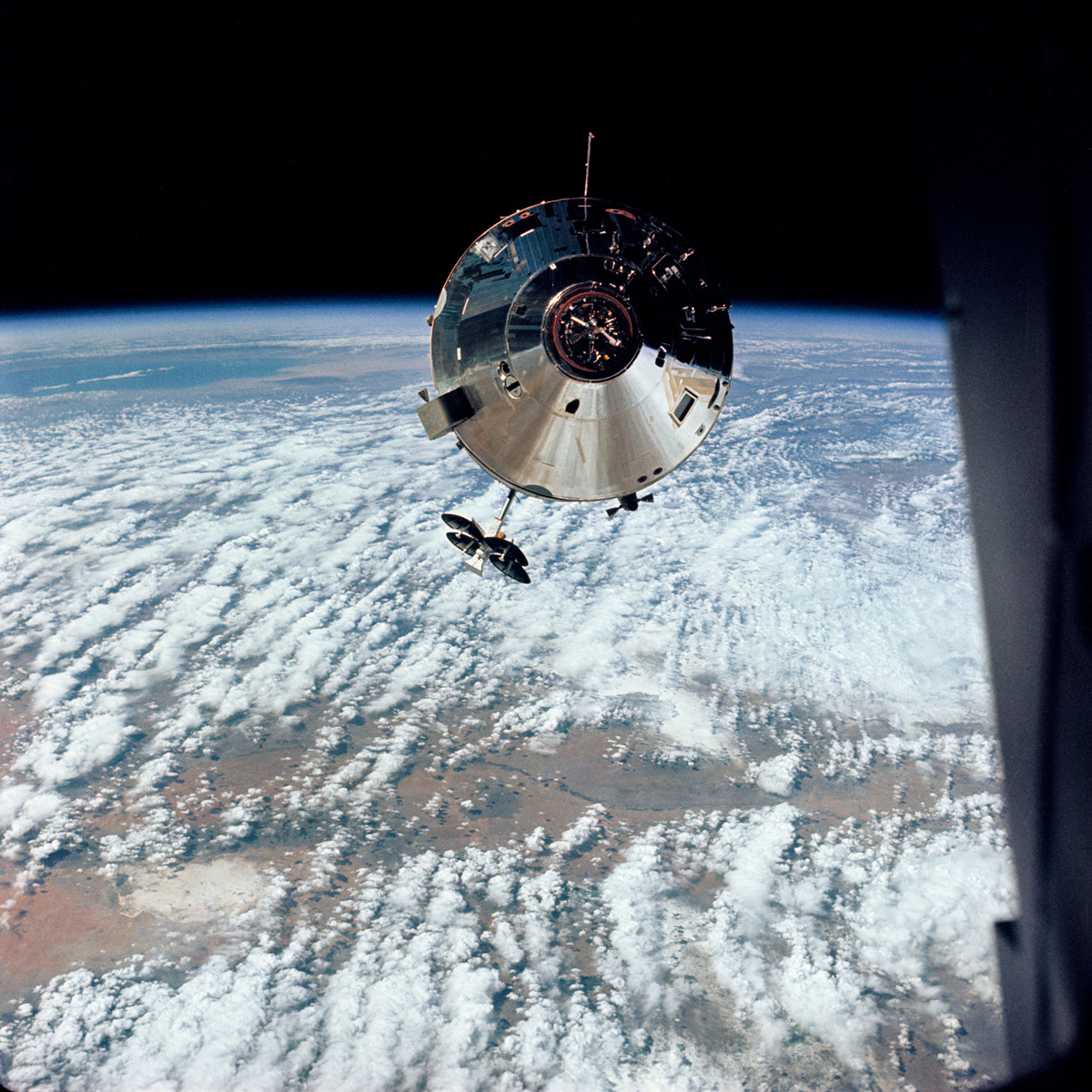 Apollo 9 command module in space with Earth in background