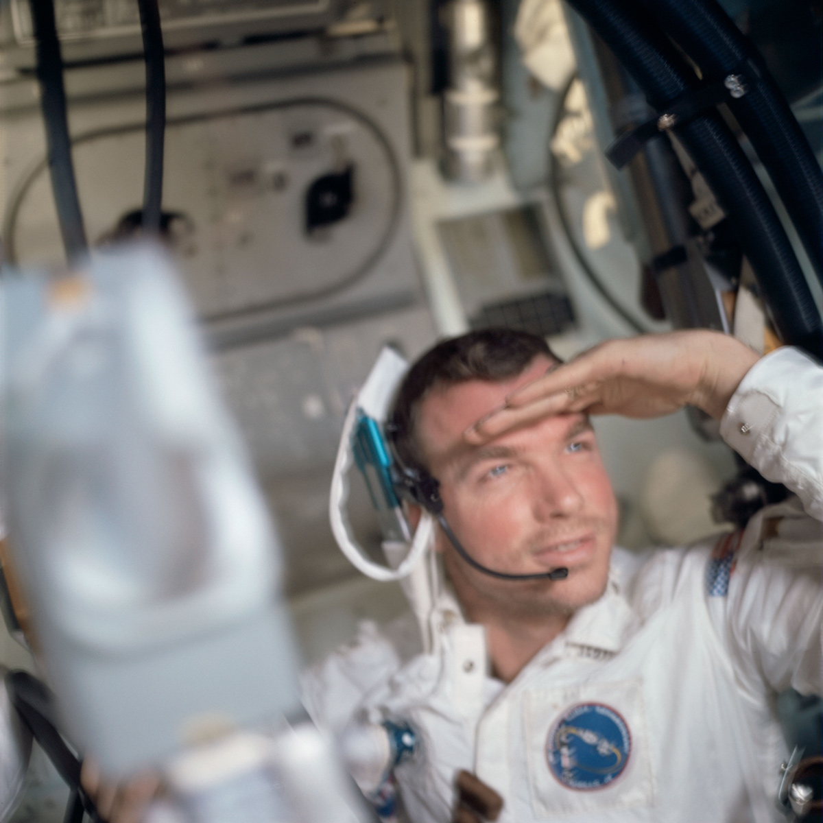 Astronaut in main cabin of Apollo 9 Command Module