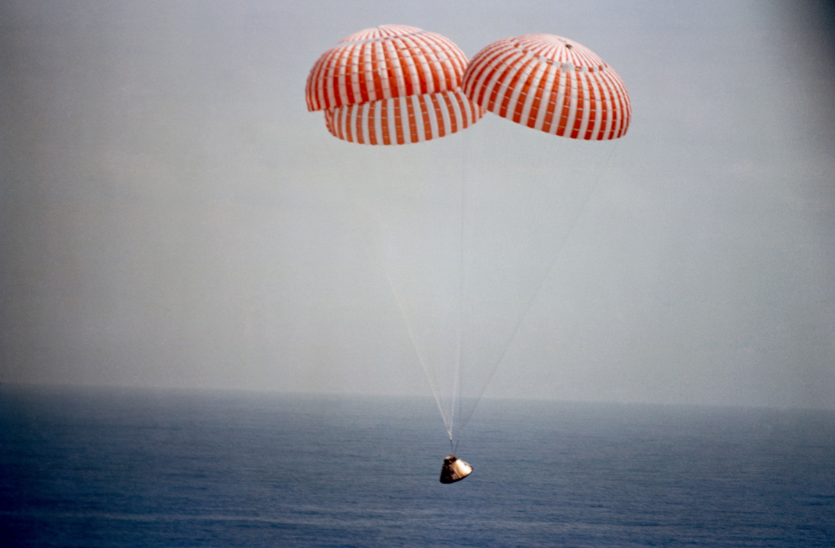 Apollo 9 spacecraft approaching splashdown with parachutes deployed