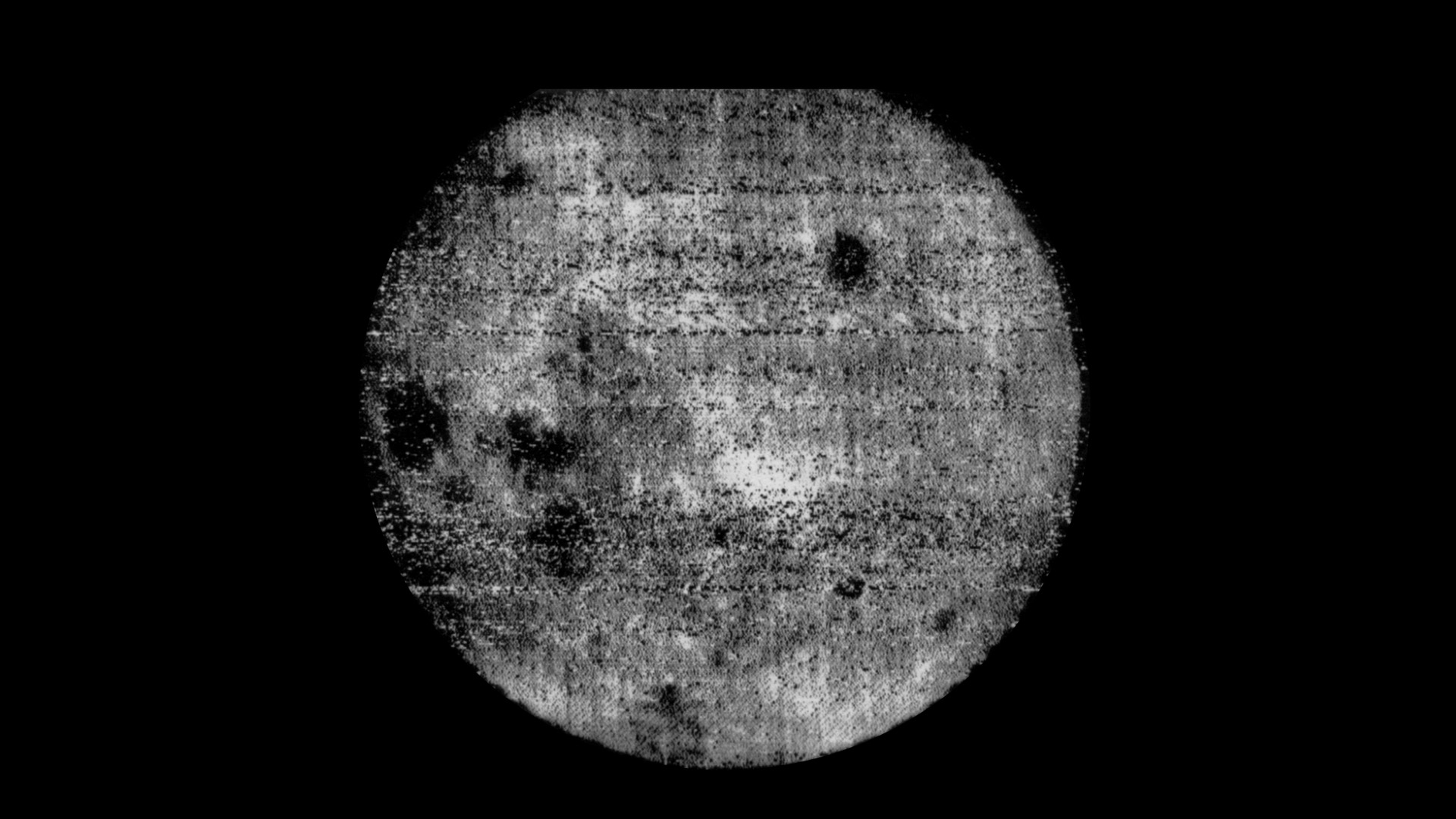 Fuzzy black and white image of the Moon.
