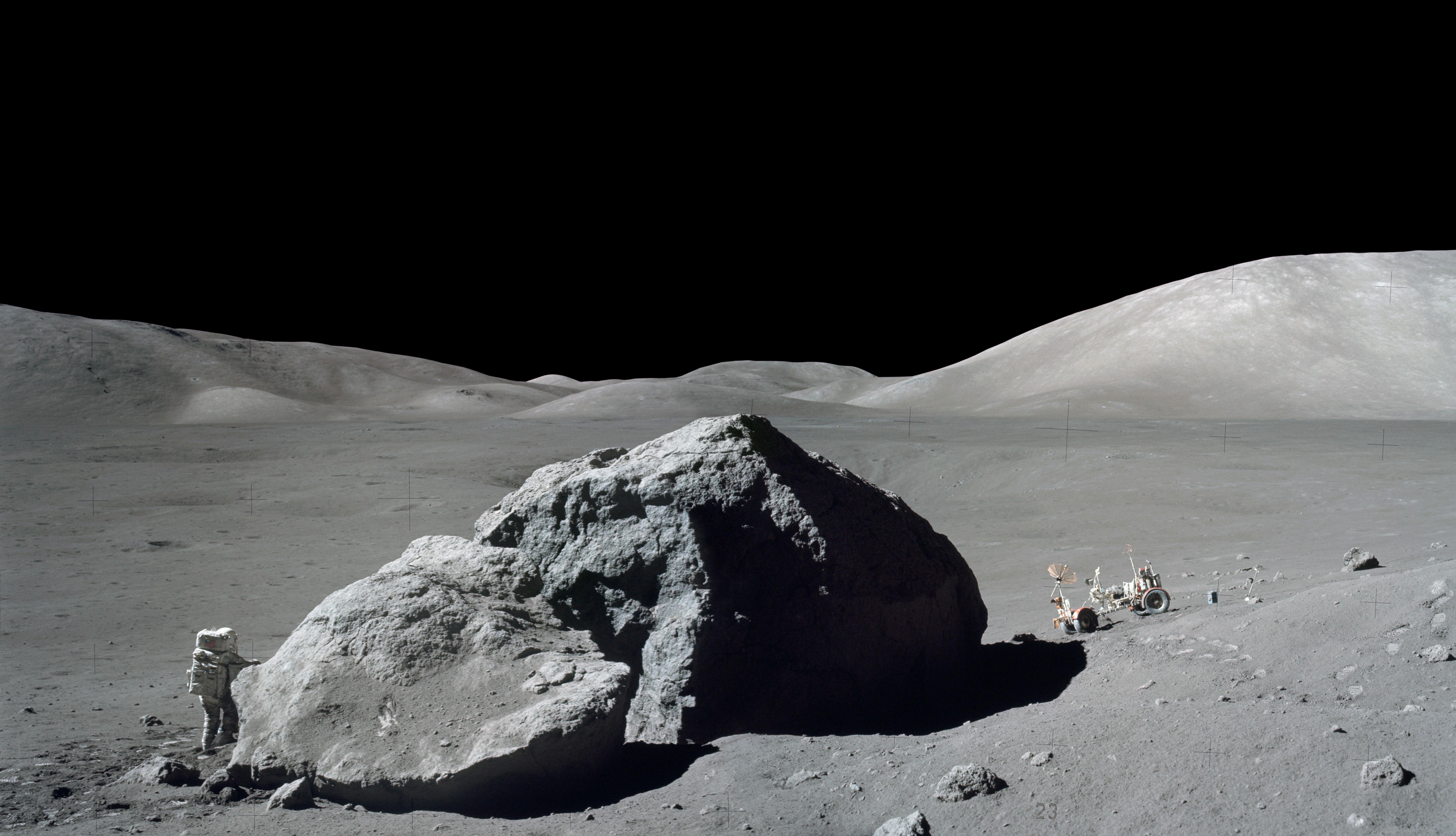 Astronaut and rover on the Moon