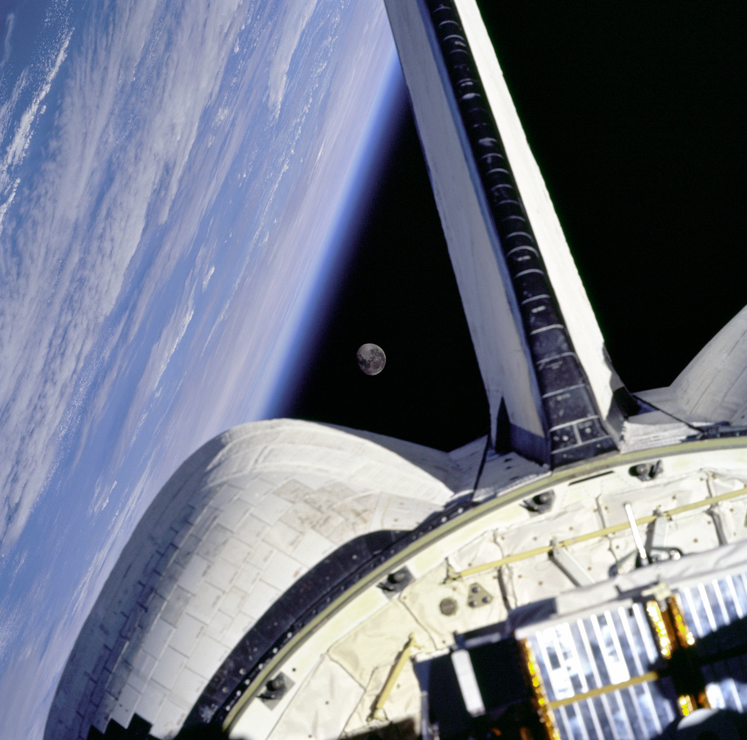 Earth and its Moon are nicely framed in this image taken from the aft windows of the Space Shuttle Discovery in 1998.
