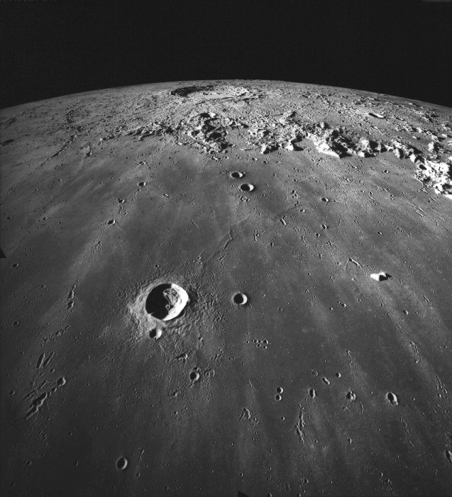 The crater Copernicus, 93 kilometers in diameter, is seen in the distance.