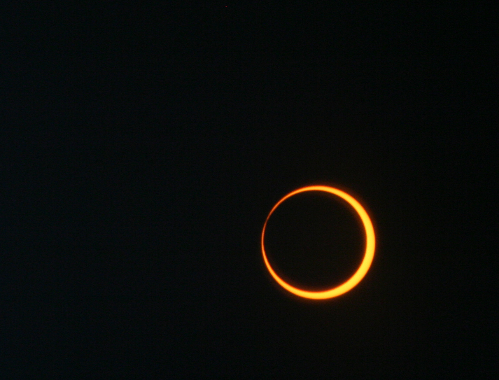 orange ring of Sun, mostly blocked by black moon