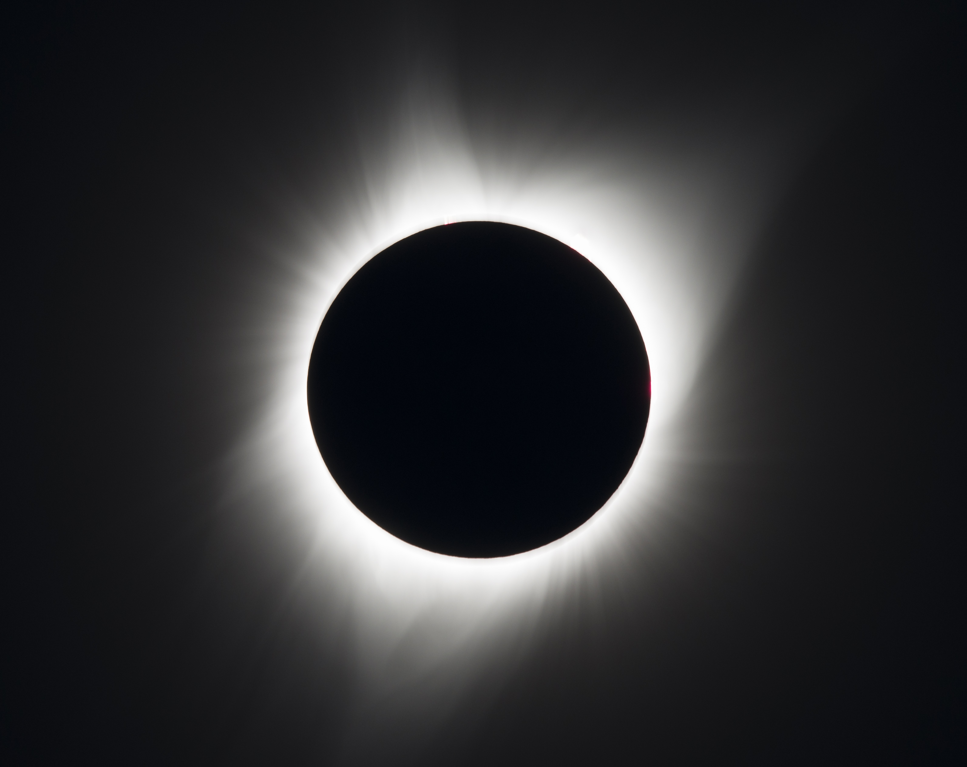 sun blocked by moon in total eclipse, with just corona visible